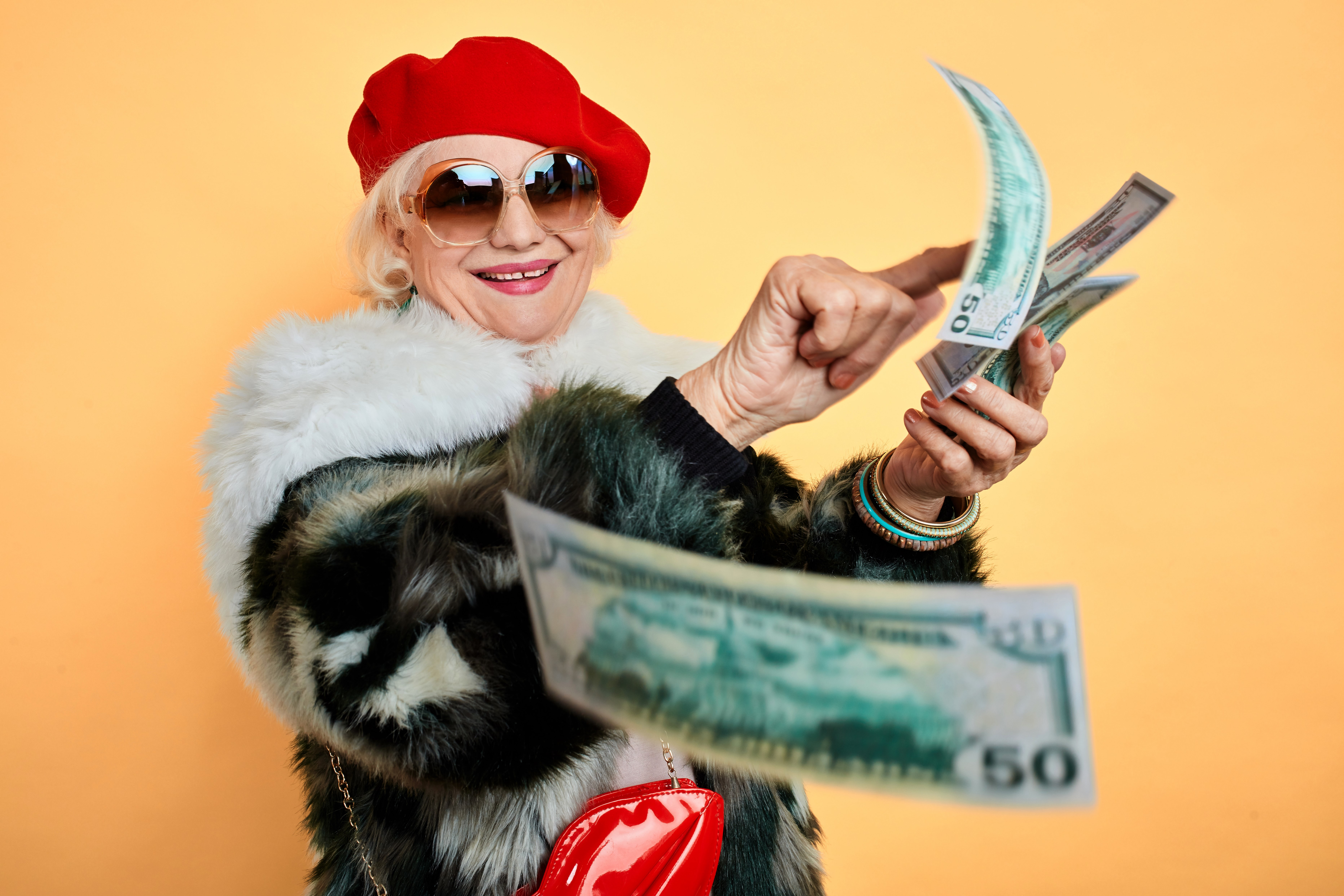 Woman%20smiling%20holding%20cash.jpg